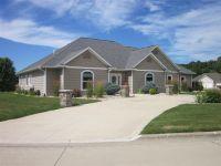 Home for sale: 909 Hidden Valley, Elgin, IA 52141