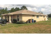 Home for sale: 4442 26th St. S.W., Lehigh Acres, FL 33973